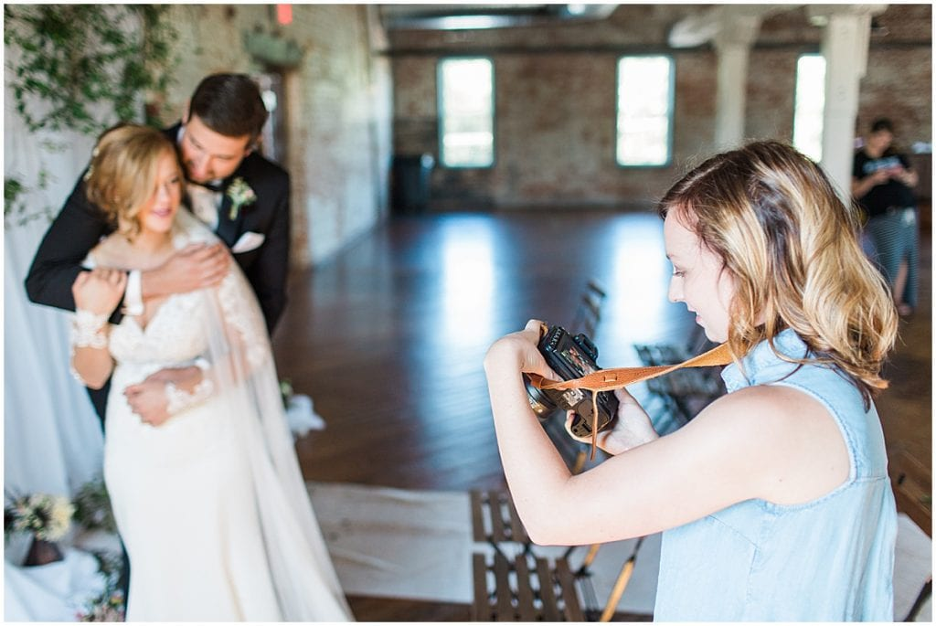Lafayette, Indiana wedding photographer Victoria Rayburn photographing a wedding