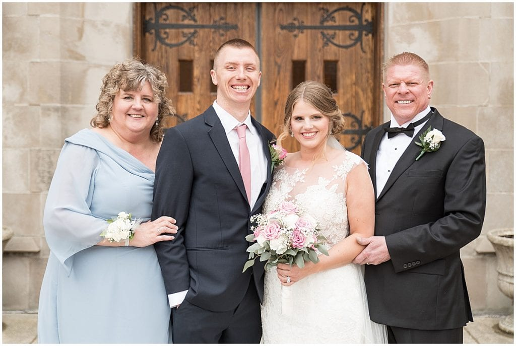 Bride and groom with brides' parents for family photos