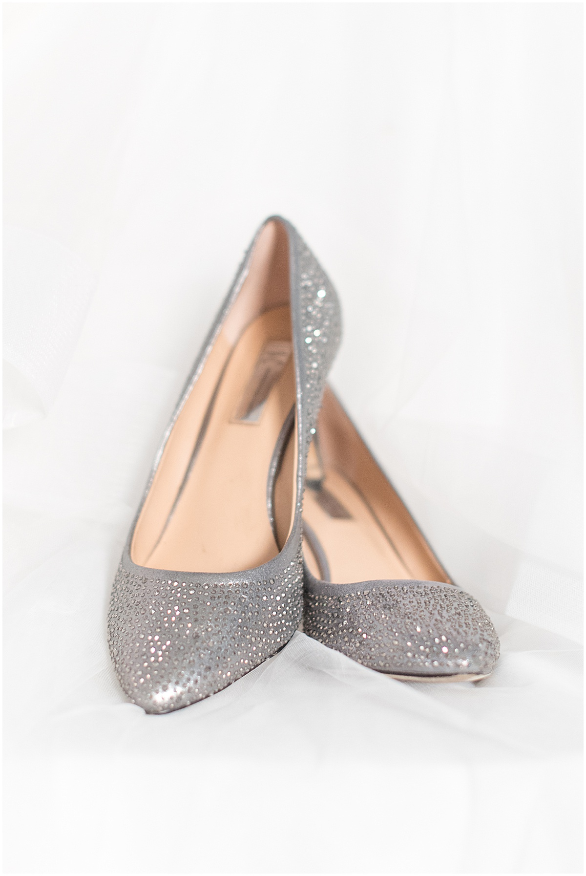 Bride's wedding shoes at Trinity United Methodist Church in Lafayette, Indiana