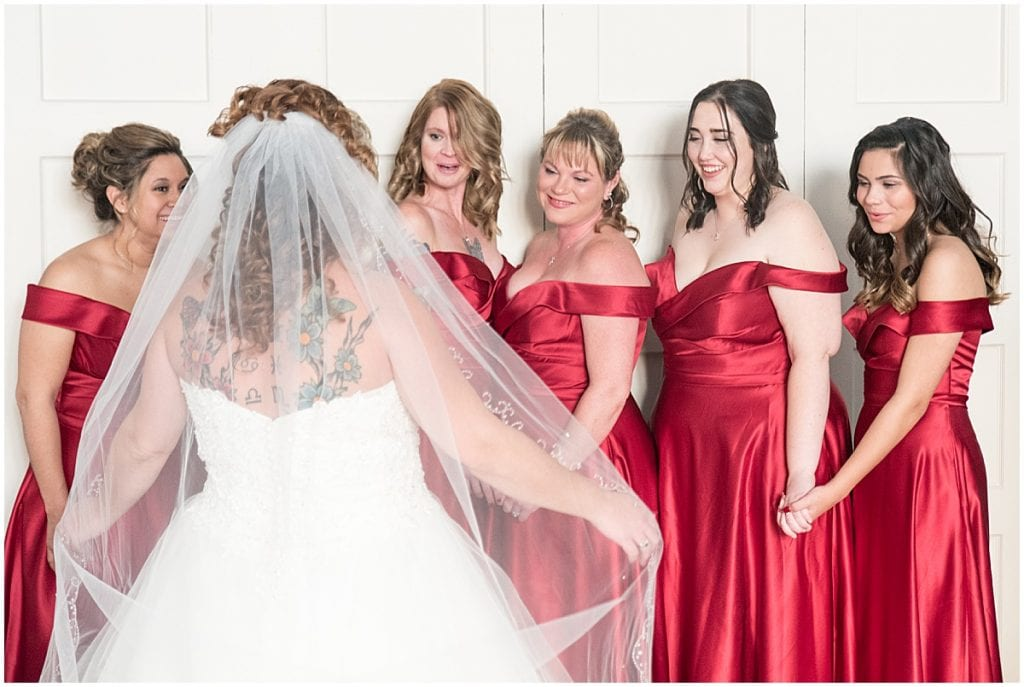Bride's first look with bridesmaids at Trinity United Methodist Church in Lafayette, Indiana