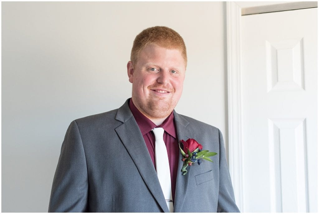 Groom getting ready for wedding at Sacred Heart Catholic Church in Fowler, Indiana