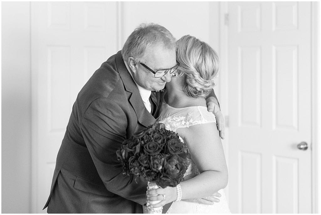 First look with dad before wedding at Sacred Heart Catholic Church in Fowler, Indiana