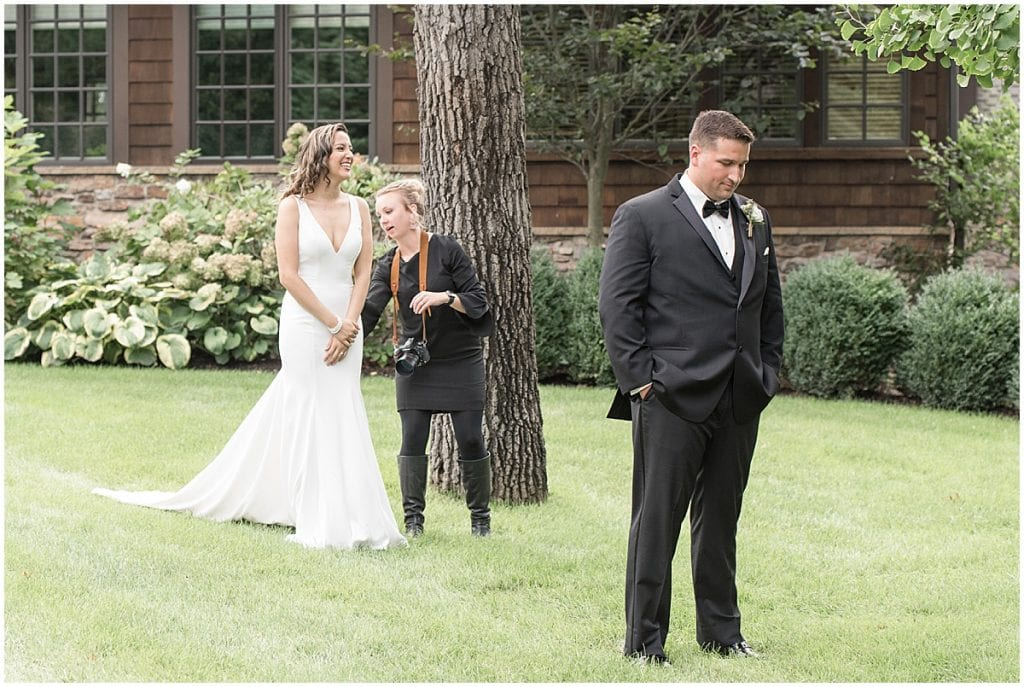 Victoria Rayburn helping bride and groom with first look