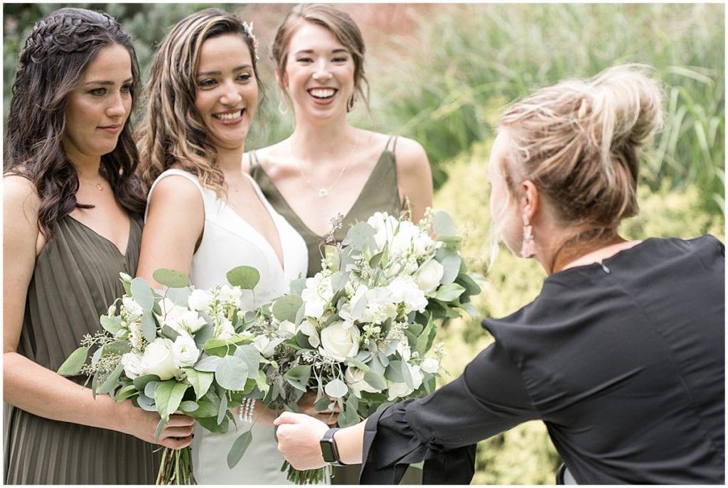 Victoria Rayburn adjusting bridesmaid bouquets
