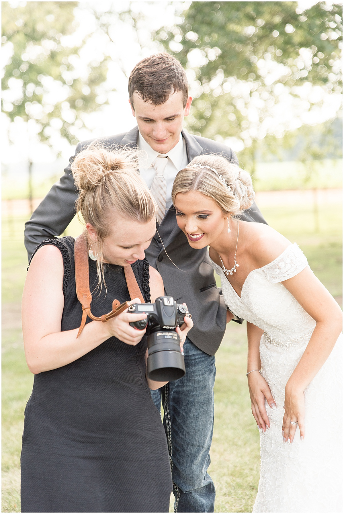Victoria Rayburn Photography showing bride and groom photos