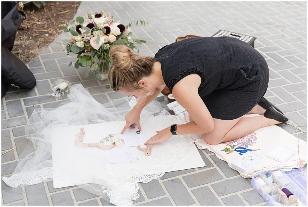 Victoria Rayburn setting up wedding details to photograph