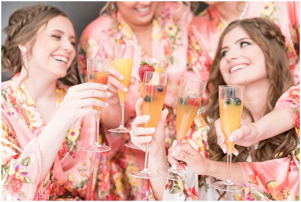 Bridal Party sipping mimosas and relaxing while getting ready.