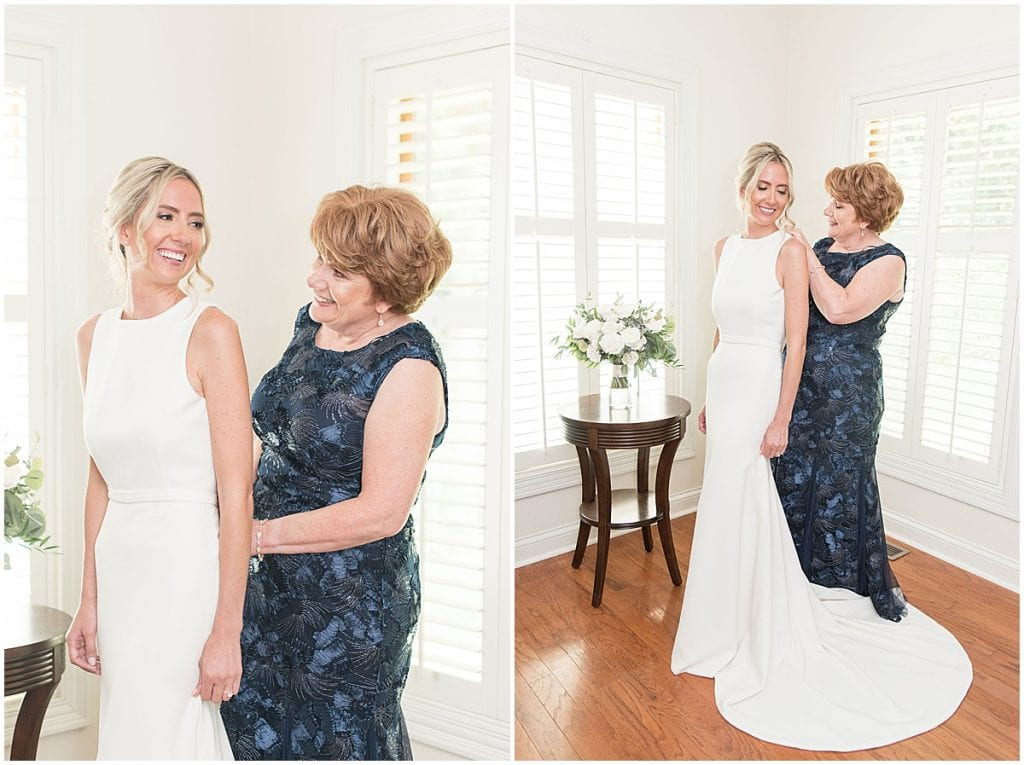 The bride's mother helping the bride get ready for her wedding.
