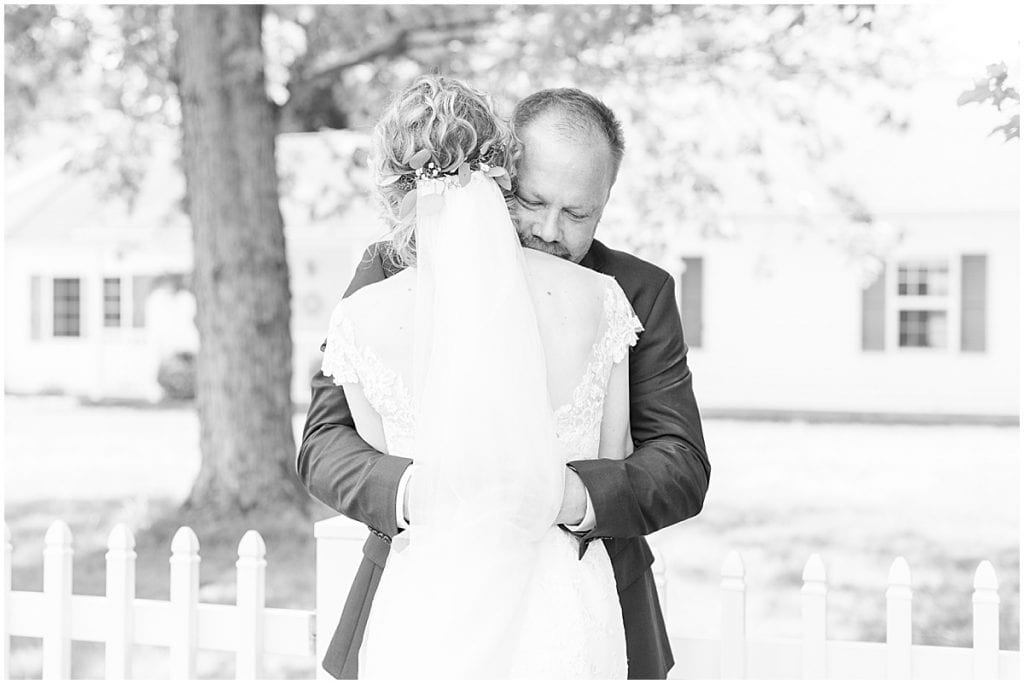 Bride's first look with her dad before wedding at The Matterhorn in Elkhart, Indiana