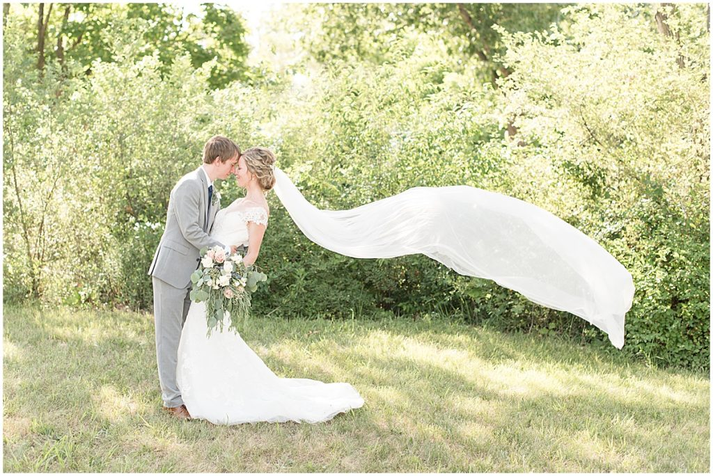 Bride and groom portraits after wedding at he Matterhorn in Elkhart, Indiana