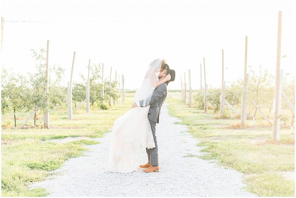 Bride and groom sunset photos during wedding at Wea Creek Orchard in Lafayette, Indiana