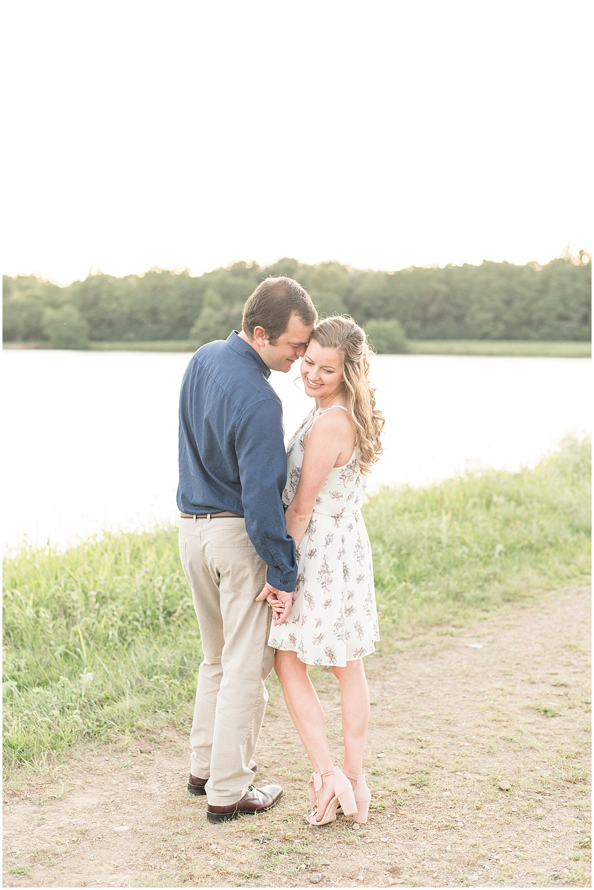 Couple holding hands for Lakefront engagement photos in Lafayette, Indiana