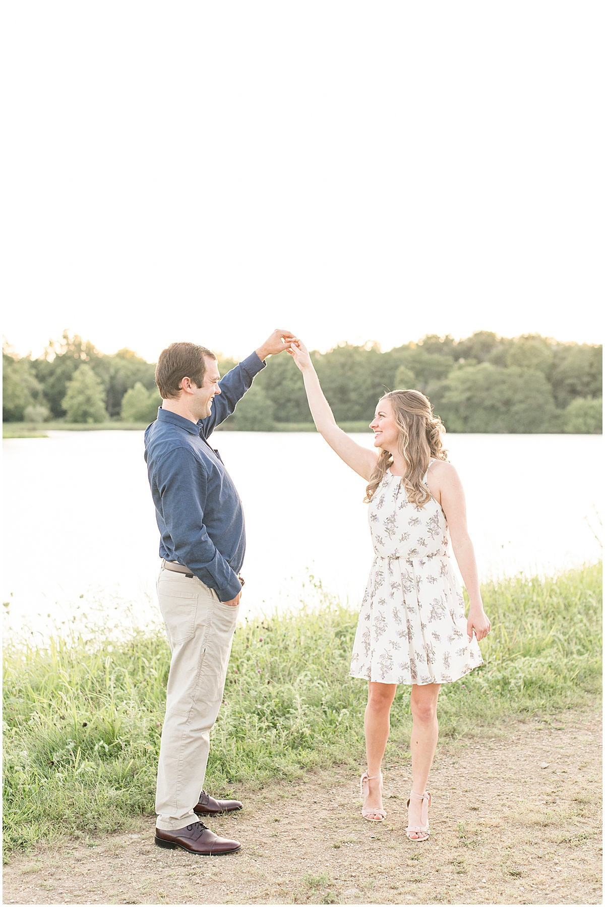 Dancing by the water during Lakefront engagement photos in Lafayette, Indiana