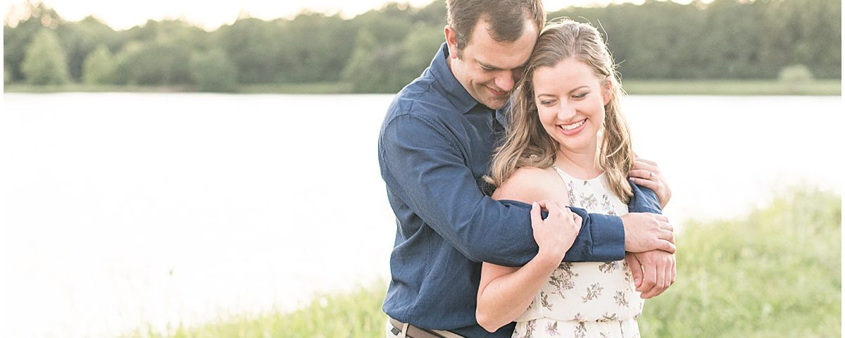 Engaged couple hugging in Lakefront engagement photos in Lafayette, Indiana