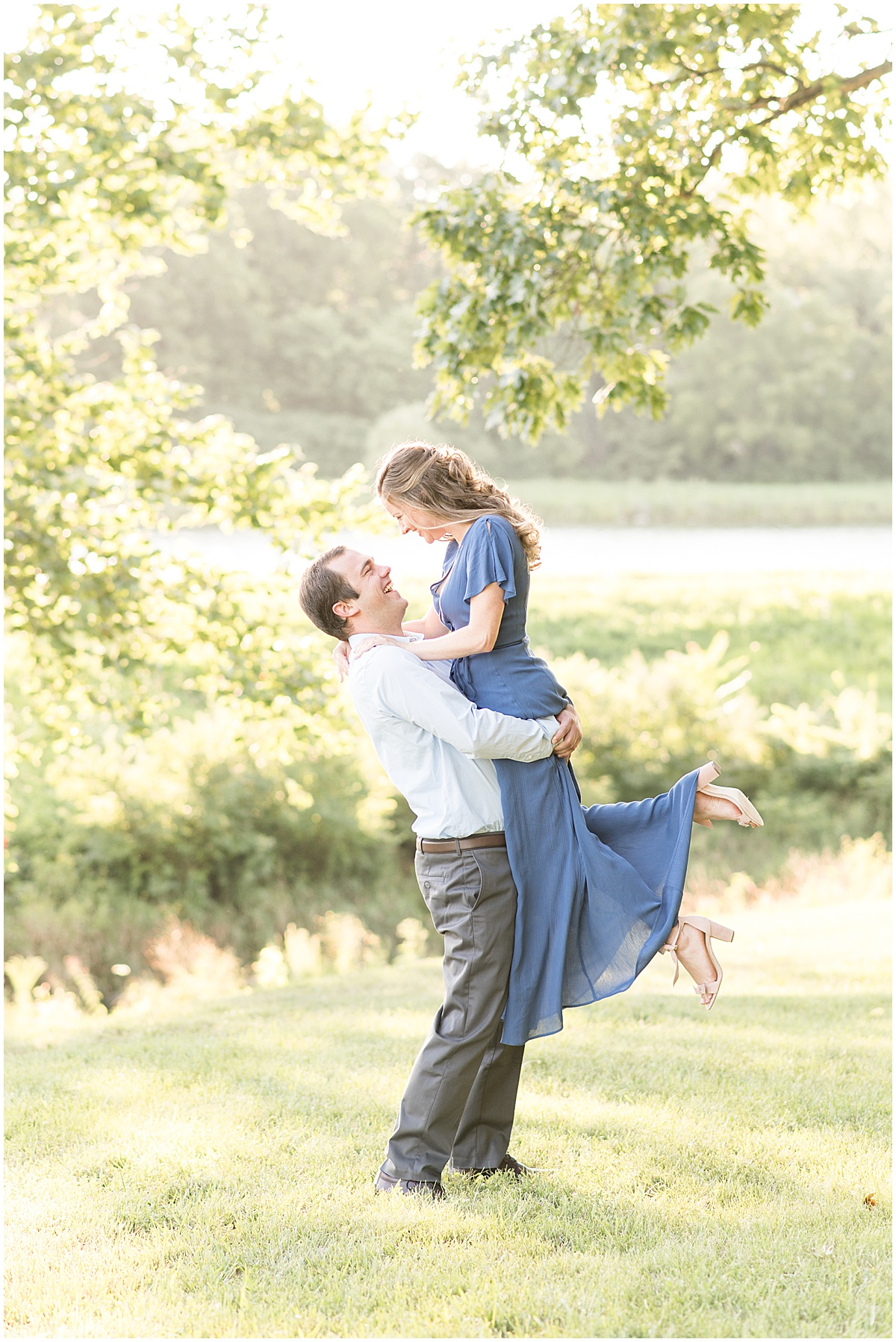 Future groom lifting future bride during Lakefront engagement photos in Lafayette, Indiana