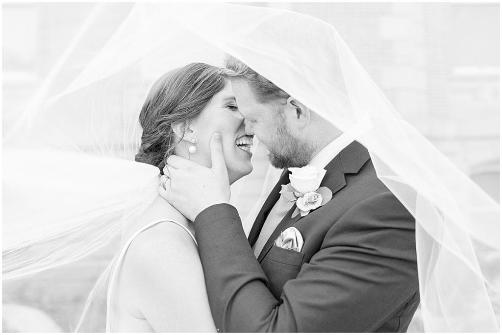 Newlyweds in veil at Spohn Ballroom wedding in Goshen, Indiana