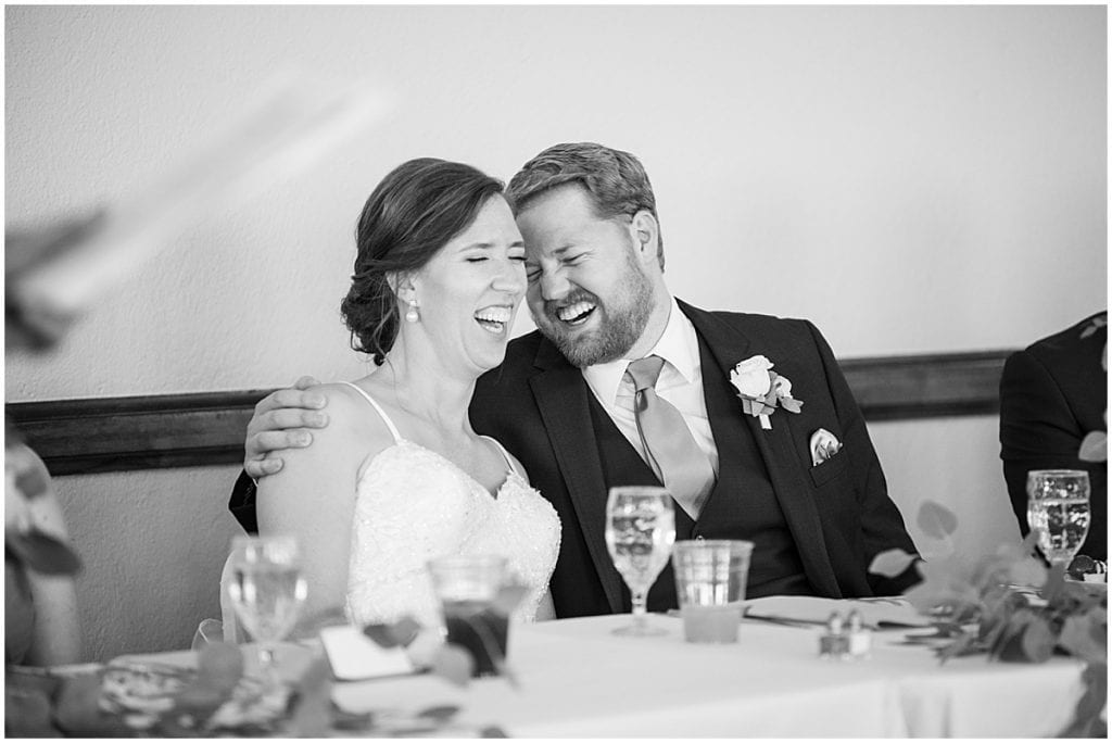 Bride and groom laughing at Spohn Ballroom wedding in Goshen, Indiana