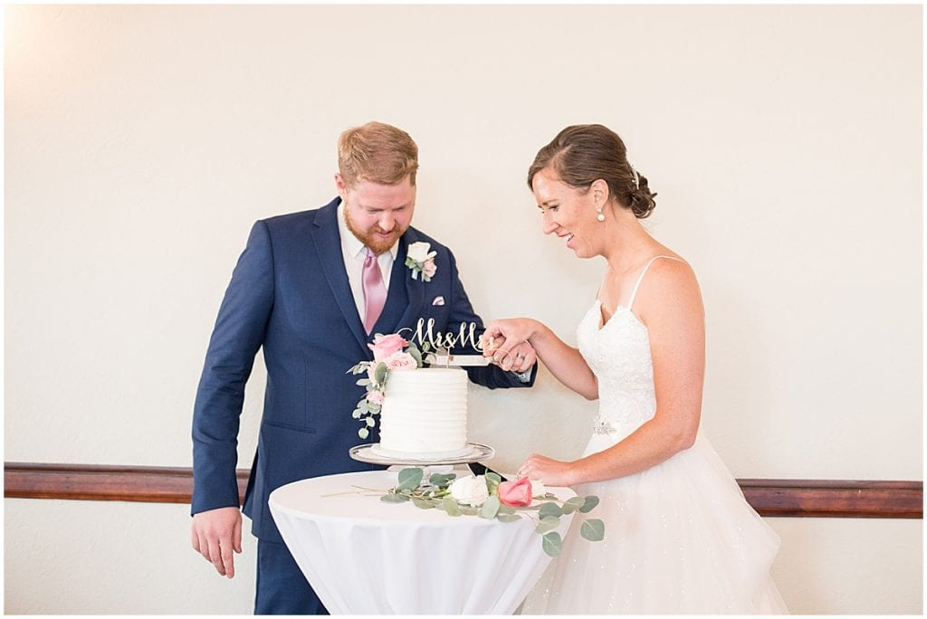 Cake cutting at Spohn Ballroom wedding in Goshen, Indiana