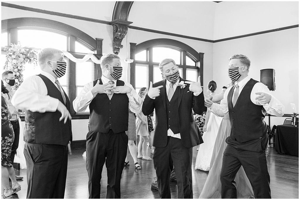 Dancing in masks at Spohn Ballroom wedding in Goshen, Indiana