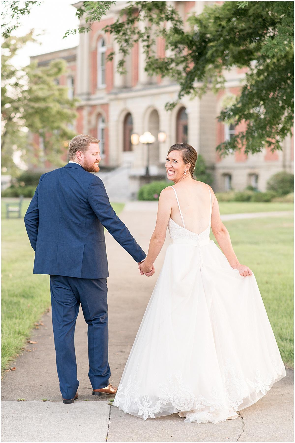 Bride and groom walking outside of Spohn Ballroom wedding in Goshen, Indiana