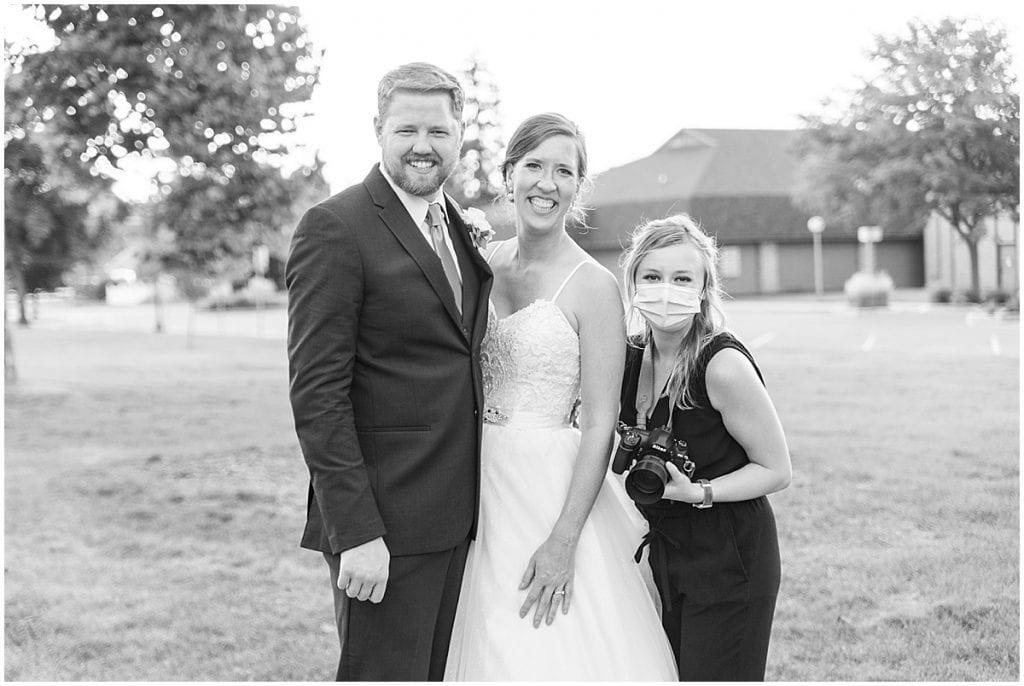 Photographer with the married couple atSpohn Ballroom wedding in Goshen, Indiana