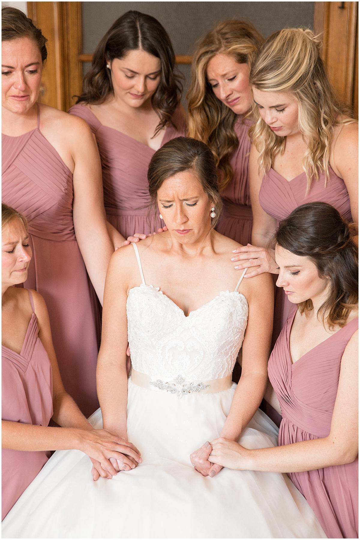 Bride praying at Spohn Ballroom wedding in Goshen, Indiana