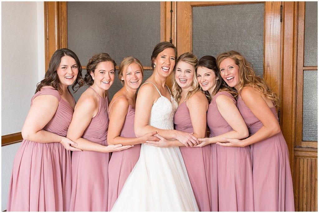 Bride with bridesmaids at Spohn Ballroom wedding in Goshen, Indiana