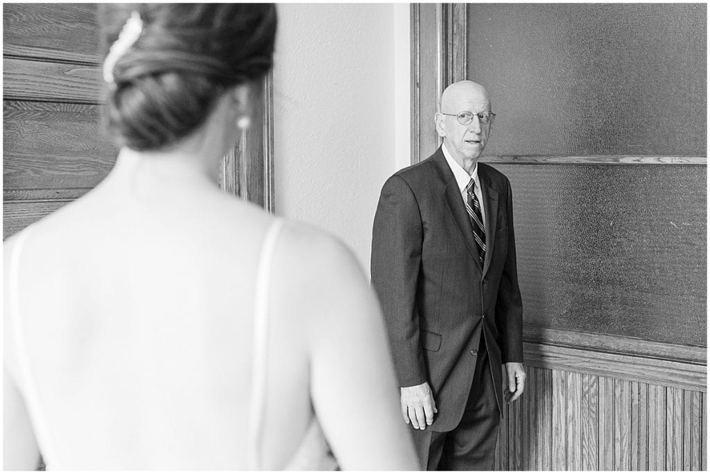 Bride first look with father at Spohn Ballroom wedding in Goshen, Indiana
