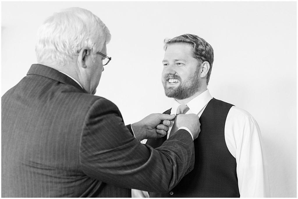Groom getting ready at Spohn Ballroom wedding in Goshen, Indiana