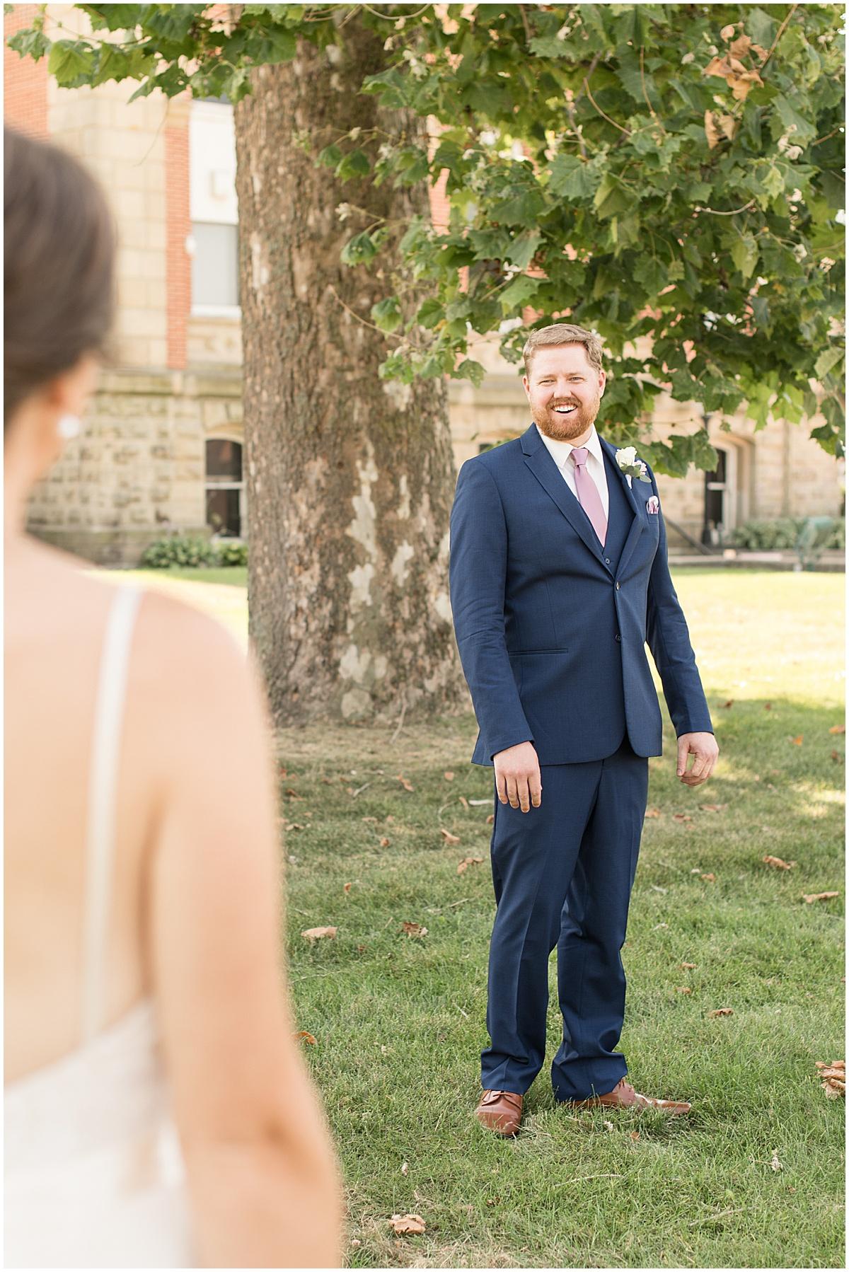 Grooms reaction to first look at Spohn Ballroom wedding in Goshen, Indiana
