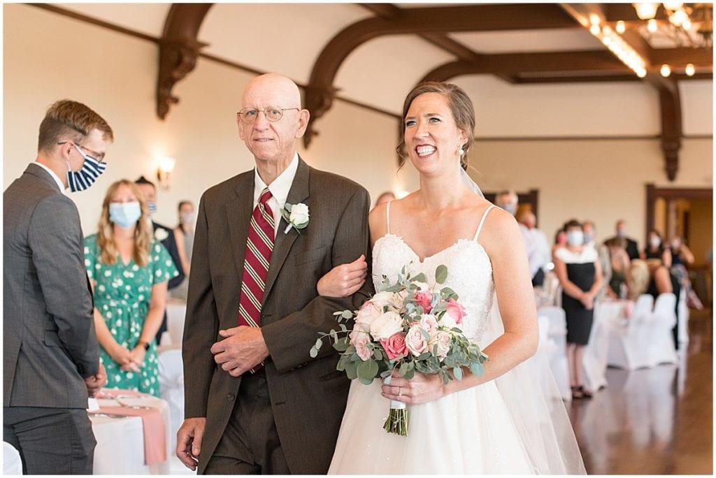 Bride walking down the aisle at Spohn Ballroom wedding in Goshen, Indiana