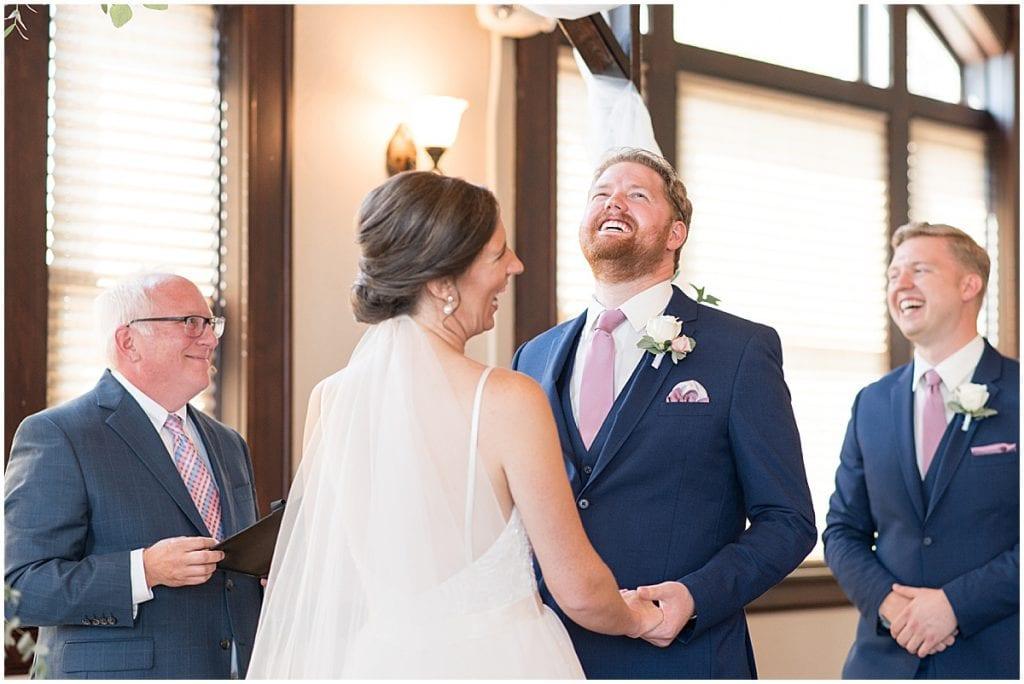 Laughing couple from Spohn Ballroom wedding in Goshen, Indiana