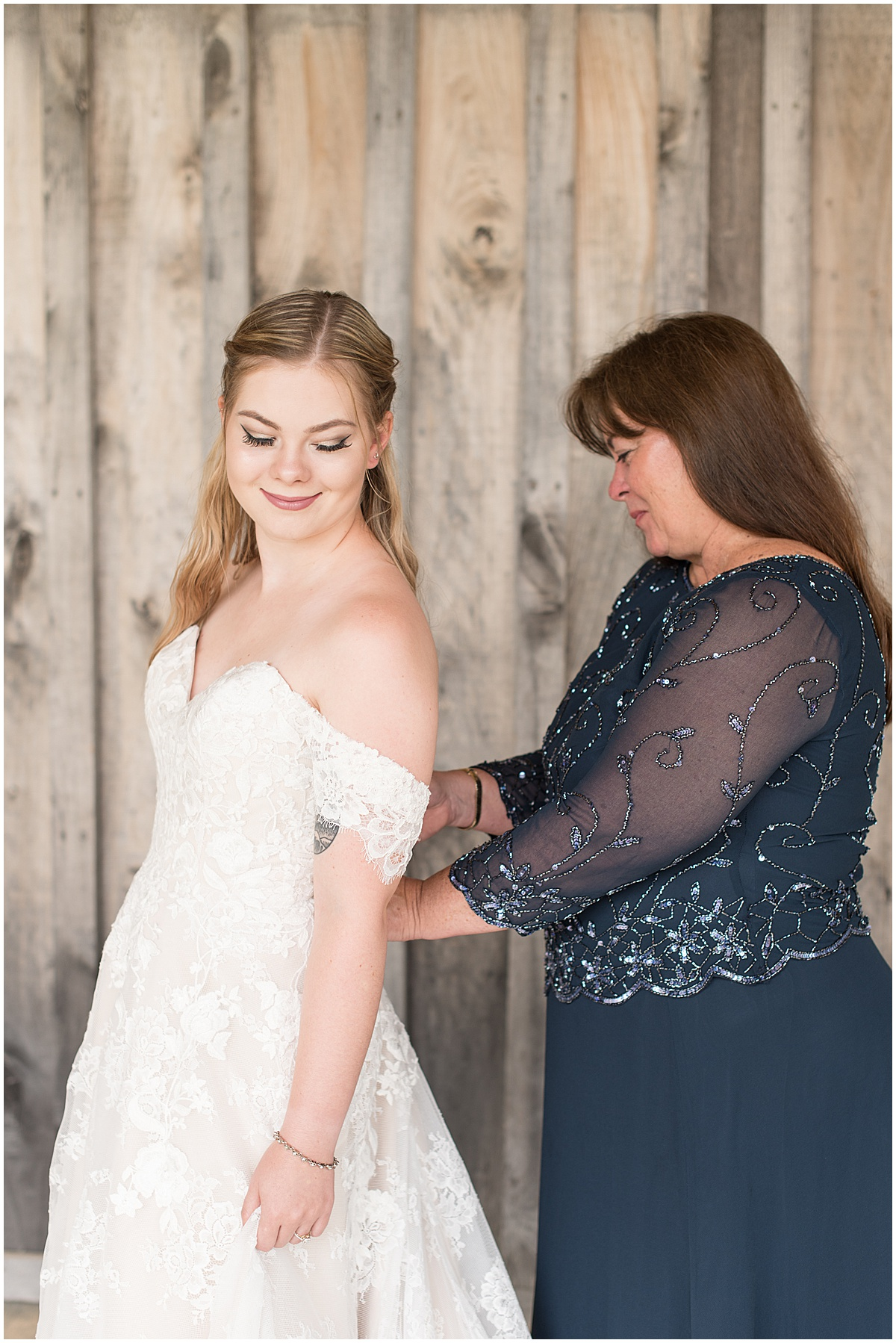 Bride getting ready for wedding at Whippoorwill Hill in Bloomington, Indiana