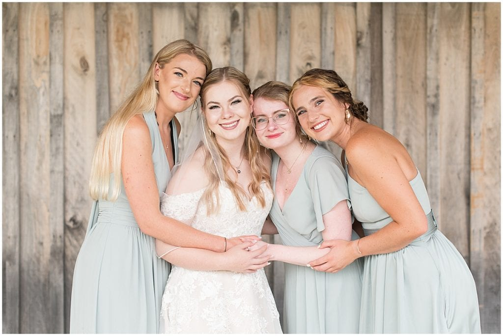 Bride's first look with bridesmaids before wedding at Whippoorwill Hill in Bloomington, Indiana
