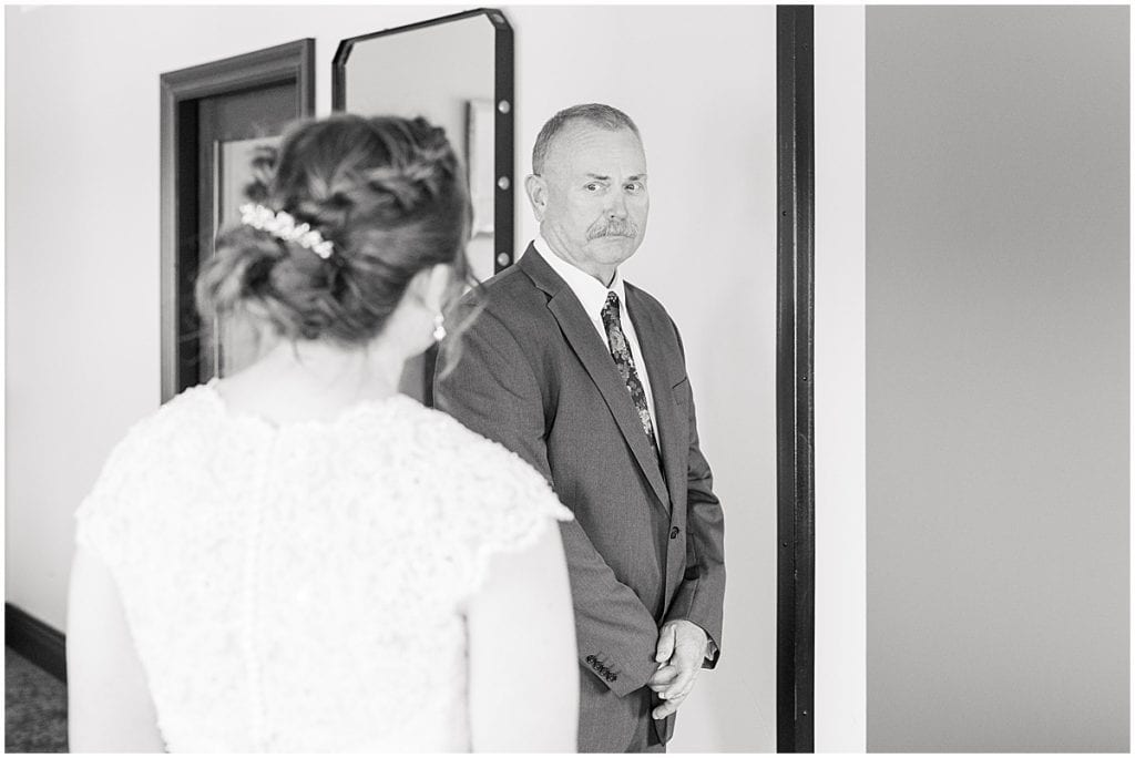 First look with Father of the bride in intimate wedding at Holliday Park in Indianapolis