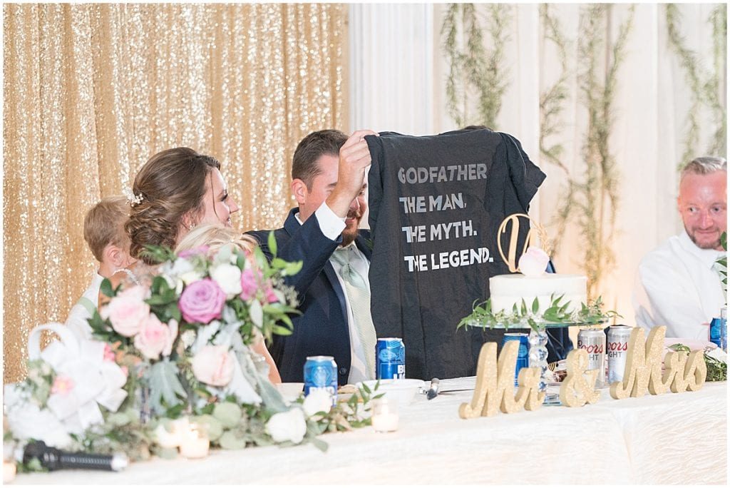 Bride and groom opening gifts during reception in Rensselaer, Indiana at the Jasper County fairgrounds