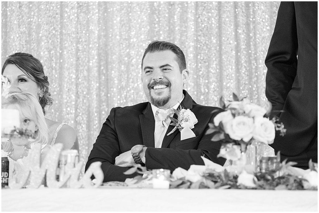 Groom's reaction to speeches during reception in Rensselaer, Indiana at the Jasper County fairgrounds