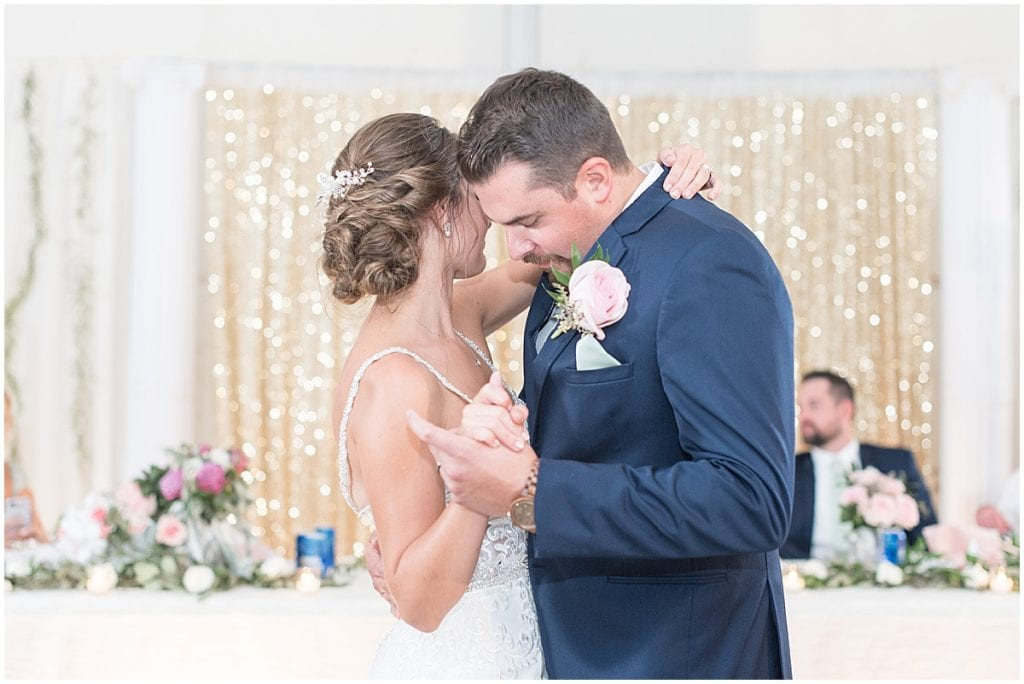 Bride and groom dancing during reception in Rensselaer, Indiana at the Jasper County fairgrounds