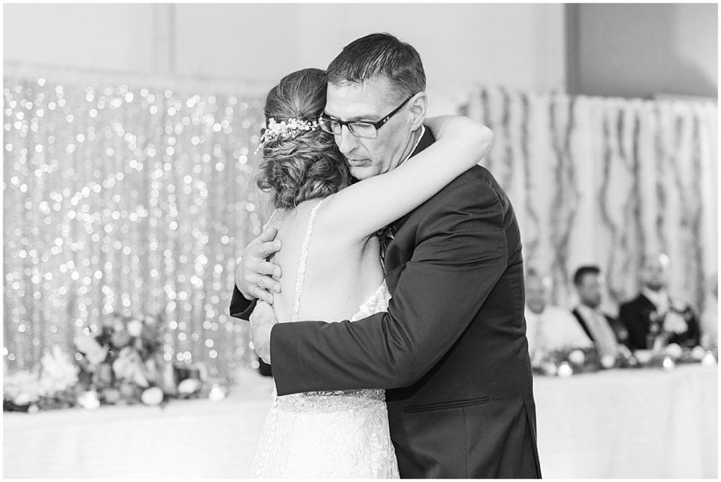 Bride and father dancing during reception in Rensselaer, Indiana at the Jasper County fairgrounds