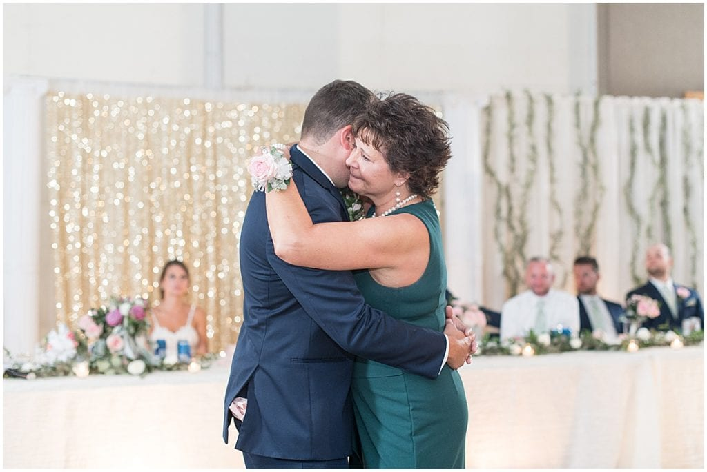 Groom and his mother dancing during reception in Rensselaer, Indiana at the Jasper County fairgrounds