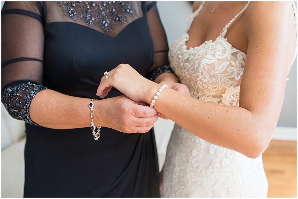 Mother of the bride helps bride get ready for Rensselaer, Indiana wedding