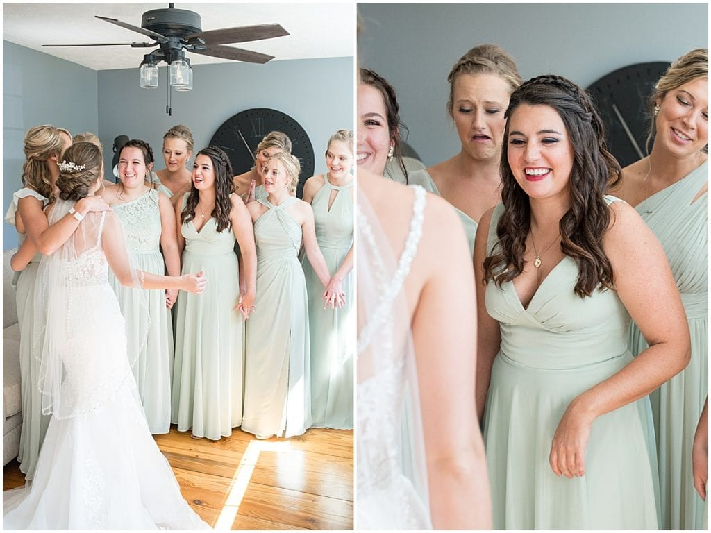 Bridesmaids react to bride before her ceremony at Trinity United Methodist Church in Rensselaer, Indiana.