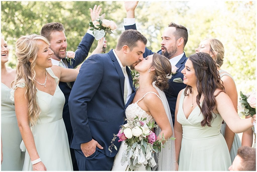 Bridal party full of joy prior to ceremony at Rensselaer, Indiana wedding