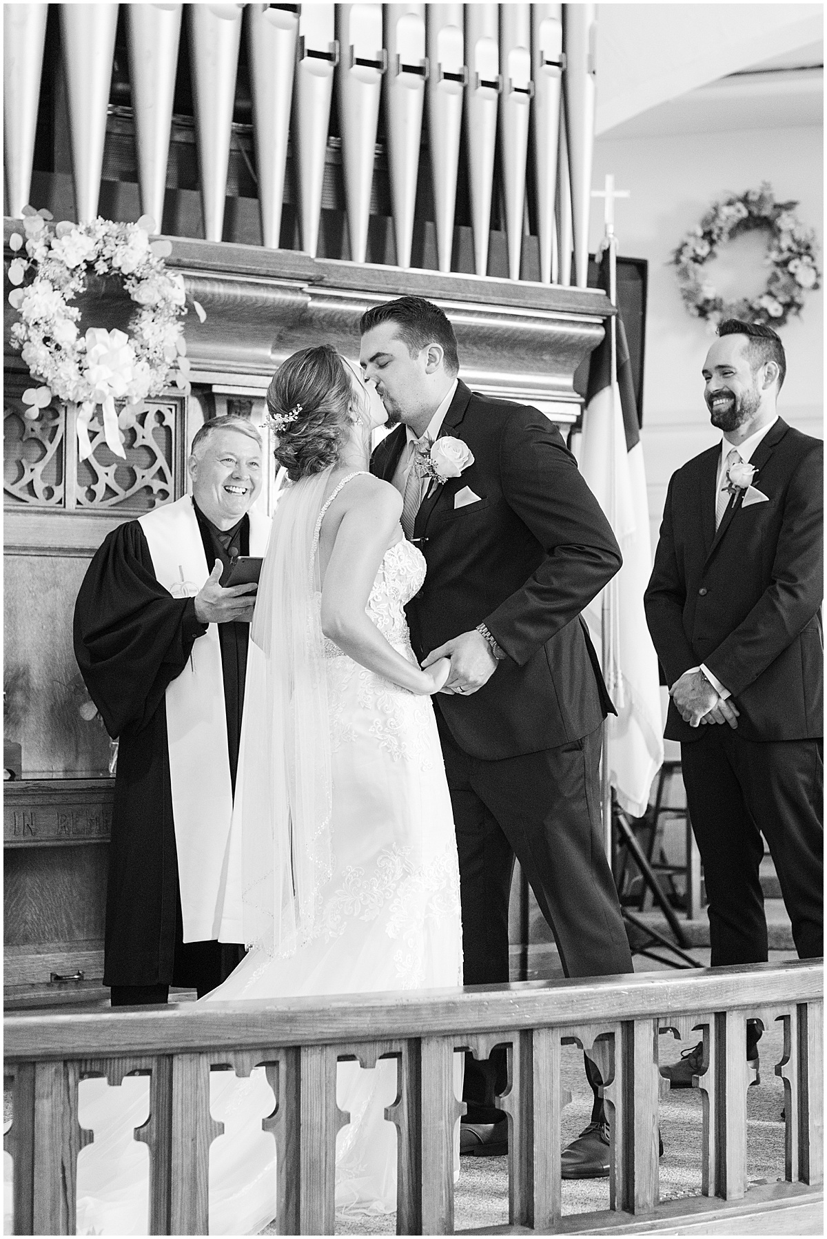First kiss in wedding ceremony at Trinity United Methodist Church in Rensselaer, Indiana