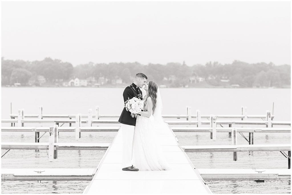 Couple portraits on pier in Cedar Lake, Indiana