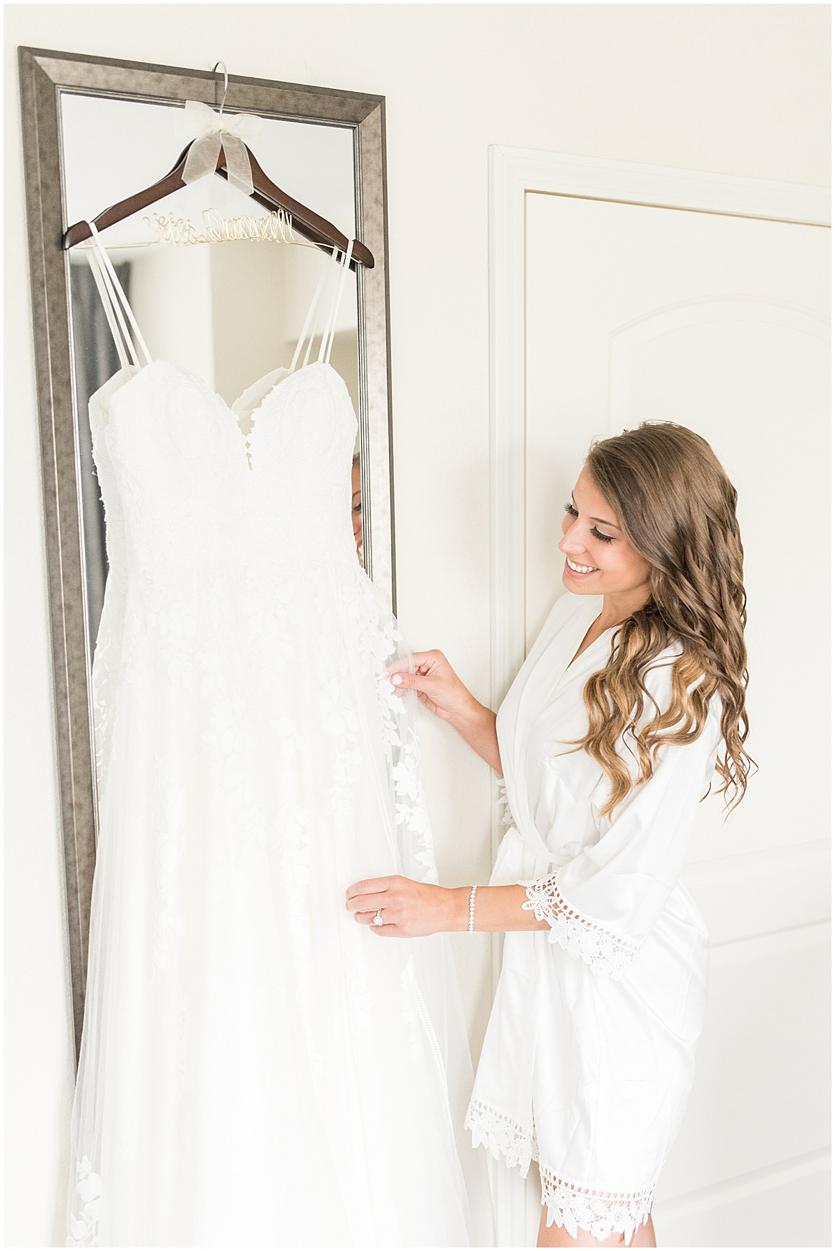 Bride admiring dress before her wedding at the Lighthouse Restaurant in Cedar Lake, Indiana