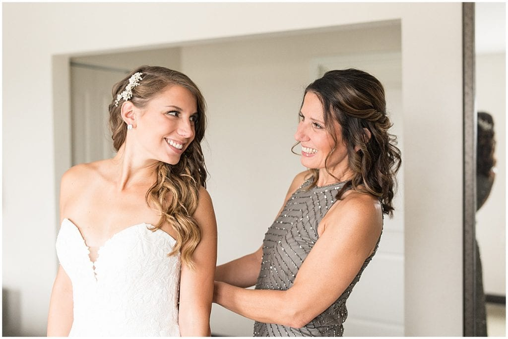 Mother of the bride helping bride get ready for her wedding in Cedar Lake, Indiana