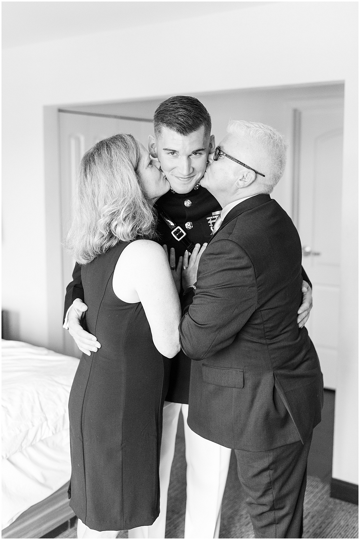 Groom's parents enjoy last few moments with the groom before his wedding in Cedar Lake, Indiana