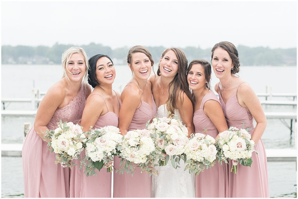 Bride laughing with bridesmaids before wedding in Cedar Lake, Indiana