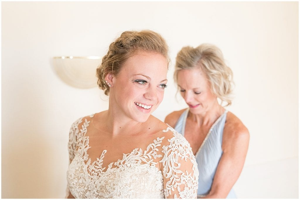 Bride getting ready for wedding at Wagner Angus Barn in Wolcott, Indiana